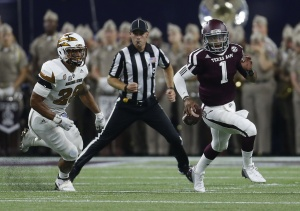 Texas A&M Aggies quarterback Kyler Murray (1) runs the ball against Arizona State Sun Devils defensive back Lloyd Carrington (8) during the first half of a college football game during the Advocare Texas Kickoff game at NRG Stadium on Saturday, Sept. 5, 2015. ( Karen Warren / Houston Chronicle )