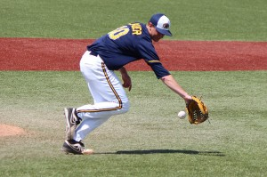 Christy Legeza CT Photo May 24, 2014 Kent State vs Western Michigan (All Pro Stadium) Kent State Pitcher Eric Lauer makes the play to get the out at first.